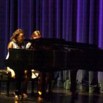"Kallista Ashton and Jenna Worton playing the piano duet, ""Take Five"" by Paul Desmond."